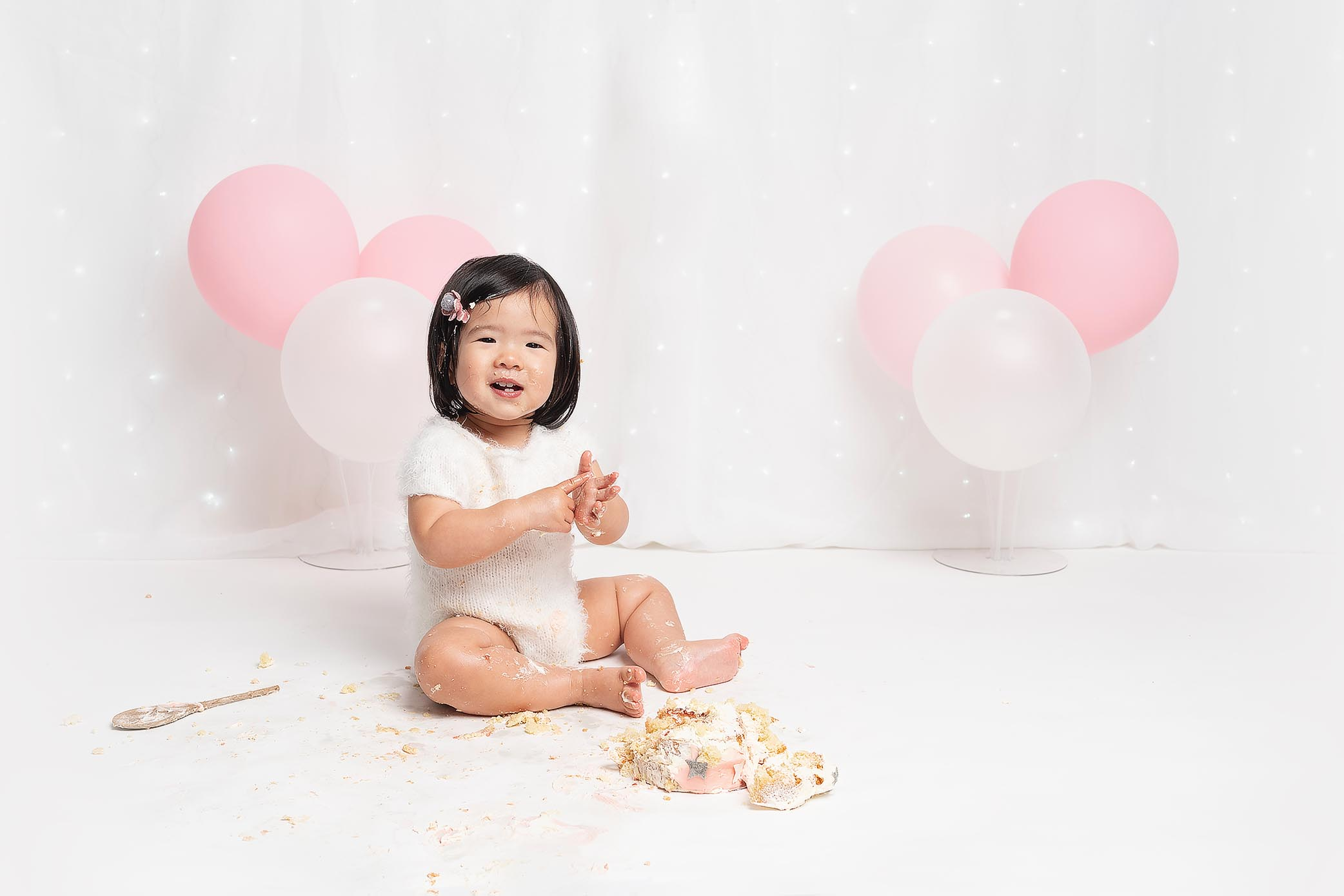smiling girl at Huntingdon cake smash photography session