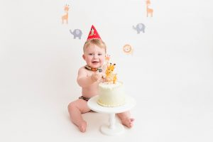 happy baby with cake at Huntingdon cake smash photography session