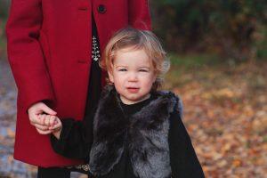 little girl posing for family photograph in Huntingdon
