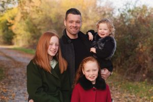 dad and children posing for family photography session in Huntingdon