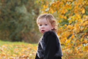 little girl posing outside on family photography session in Huntingdon