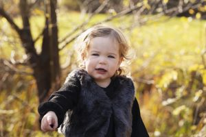 baby girl posing on family photography session in Huntingdon