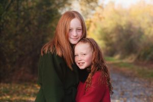 sisters posing for outdoor photography session in Huntingdon