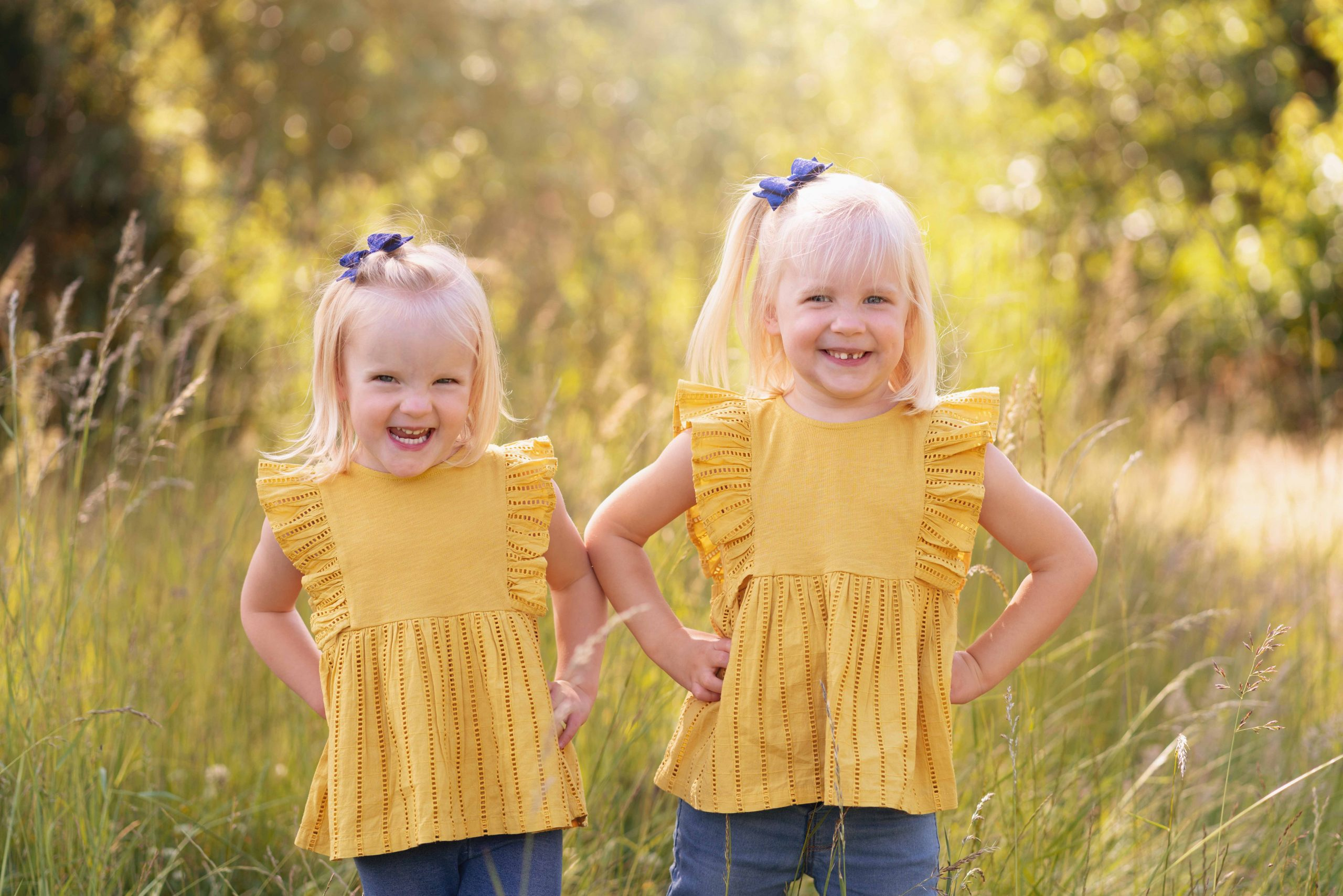 sisters posing outside on family photography session in Huntingdon