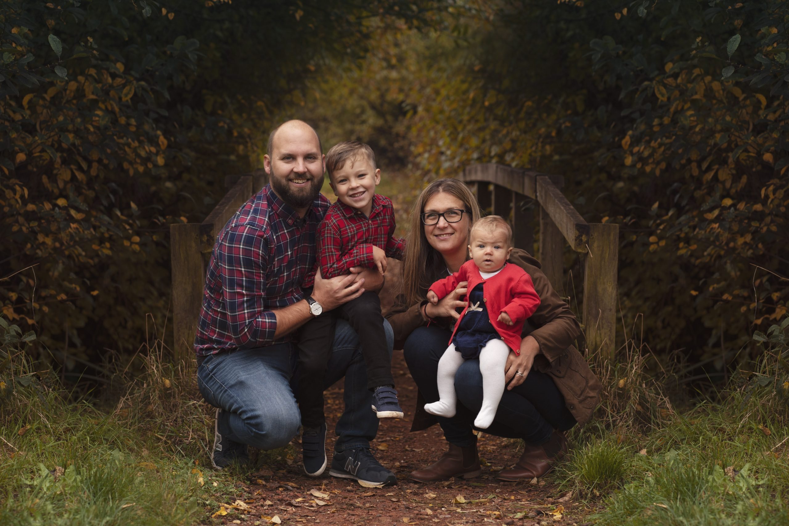 mum and dad posing with children on family photography session in Huntingdon